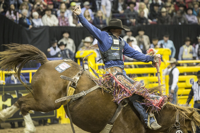 Cody Wright rides Vitalix Hell's Fire Hostage during the saddle bronc competition at the National Finals Rodeo at the Thomas & Mack Center on Tuesday, Dec. 6, 2016, in Las Vegas. Benjamin Hage ...
