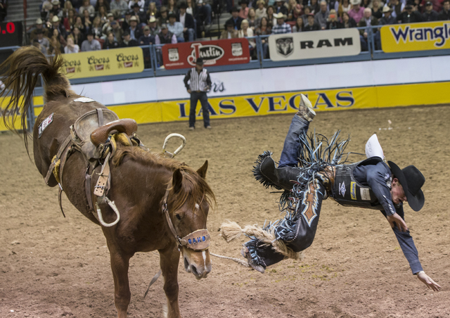 Rusty Wright rides Bridal Shower during the saddle bronc competition at the National Finals Rodeo at the Thomas & Mack Center on Tuesday, Dec. 6, 2016, in Las Vegas. Benjamin Hager/Las Vegas R ...