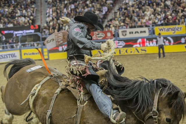 Jacobs Crawley rides Big Tex during the saddle bronc competition at the National Finals Rodeo at the Thomas & Mack Center on Tuesday, Dec. 6, 2016, in Las Vegas. Benjamin Hager/Las Vegas Revie ...