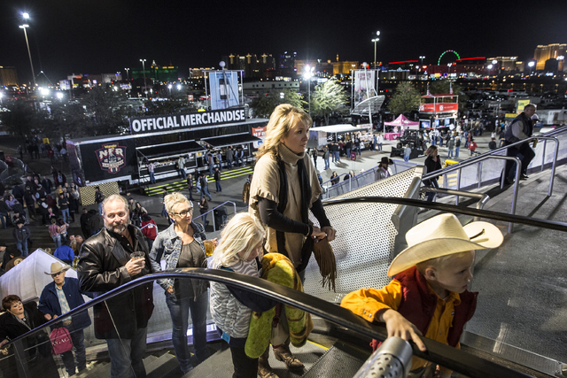 Rodeo fans enter the Thomas & Mack Center during the sixth night of the National Finals Rodeo on Tuesday, Dec. 6, 2016, in Las Vegas. Benjamin Hager/Las Vegas Review-Journal