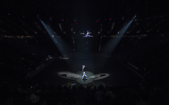 The single rider exits the arena at the end of the National Anthem during National Finals Rodeo at the Thomas & Mack Center on Tuesday, Dec. 6, 2016, in Las Vegas. Benjamin Hager/Las Vegas Rev ...