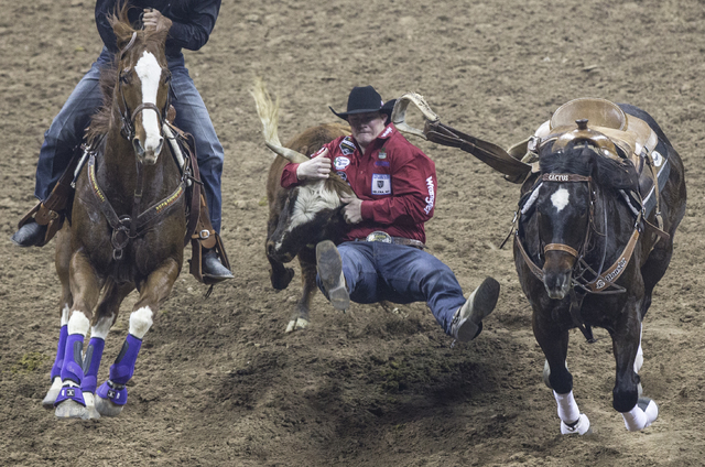 Ty Erickson competes in the steer wrestling competition at the National Finals Rodeo at the Thomas & Mack Center on Tuesday, Dec. 6, 2016, in Las Vegas. Benjamin Hager/Las Vegas Review-Journal