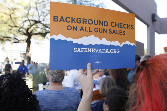 Volunteers with Nevadans for Background Checks stand outside of the Clark County Election Center in North Las Vegas during a press conference before submitting 246,674 signatures to place the Back ...