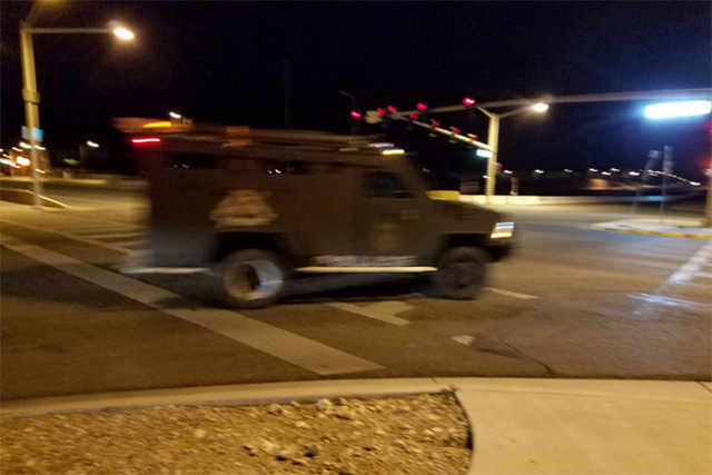 SWAT vehicles leave the scene after a woman driving a stolen pickup was taken into custody early Friday morning near the 215 and Town Center Drive.  (Mike Shoro/Las Vegas Review-Journal)