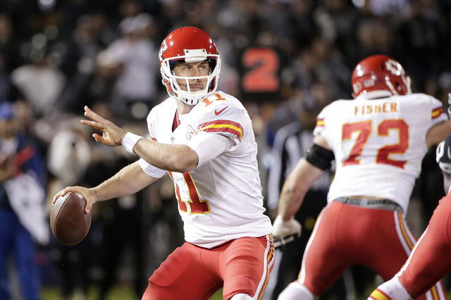 Kansas City Chiefs quarterback Alex Smith (11) passes against the Oakland Raiders during the first quarter of an NFL football game in Oakland, Calif., Thursday, Nov. 20, 2014. (AP Photo/Marcio Jos ...