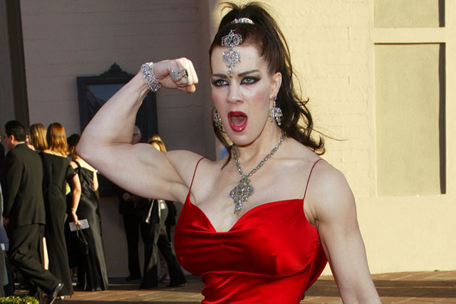 In this Nov. 16, 2003, file photo, Joanie Laurer, former pro wrestler known as Chyna, flexes her bicep as she arrives at the 31st annual American Music Awards, in Los Angeles. Chyna, the WWE star  ...