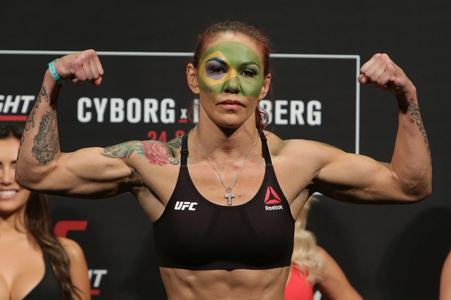 """Brazil's Cristiane Justino, known as """"Cris Cyborg,"""" poses during the weigh-in for her UFC Fight Night in Brasilia, Brazil, Friday, Sept. 23, 2016. (Eraldo Peres/AP)"""