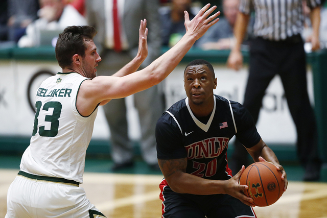 Colorado State forward Braden Koelliker, left, defends UNLV forward Christian Jones during the second half of an NCAA college basketball game Wednesday, Dec. 28, 2016, in Fort Collins, Colo. Color ...