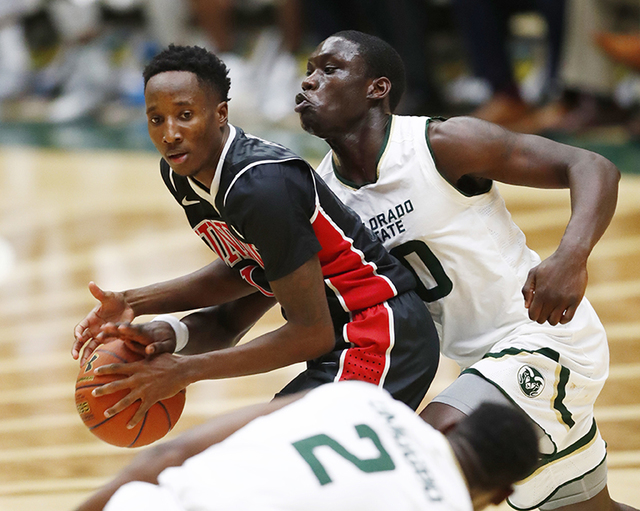 Colorado State forward Che Bob, right, knocks the ball away from UNLV guard Kris Clyburn in the second half of an NCAA college basketball game Wednesday, Dec. 28, 2016, in Fort Collins, Colo. Colo ...
