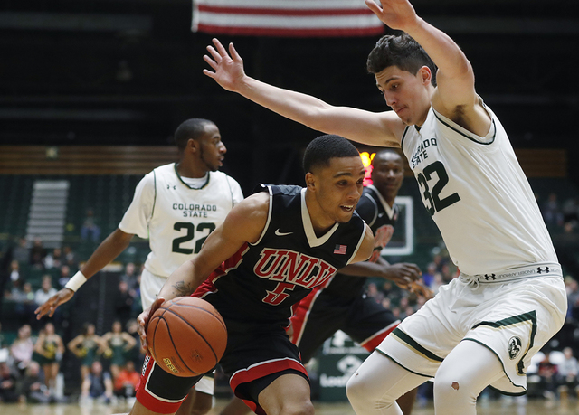 UNLV guard Jalen Poyser, left, drives to the basket as Colorado State forward Nico Carvacho defends in the second half of an NCAA college basketball game Wednesday, Dec. 28, 2016, in Fort Collins, ...
