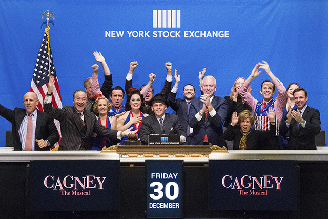 "In this photo provided by the New York Stock Exchange, actor Robert Creighton, one of the stars of ""Cagney The Musical"" joins representatives and actors from the show on the podi ..."