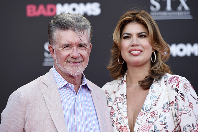 """Alan Thicke and his wife Tanya pose together at the premiere of the film """"Bad Moms"""" at the Mann Village Theatre on Tuesday, July 26, 2016, in Los Angeles. (Photo by Chris Pizzell ..."""