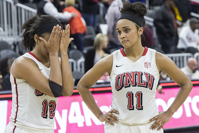UNLV players Dylan Gonzalez (11) and Dakota Gonzalez (12) console each other after coming up short against Oregon State during the Play4Kay Shootout at T-Mobile Arena on Monday, Dec. 19, 2016, in  ...