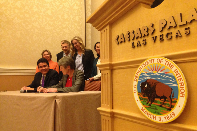 Flanked by other government officials at Caesars Palace Thursday, Interior Secretary Sally Jewell signs a 20-year management plan for Glen Canyon Dam that will allow periodic high-flow water relea ...