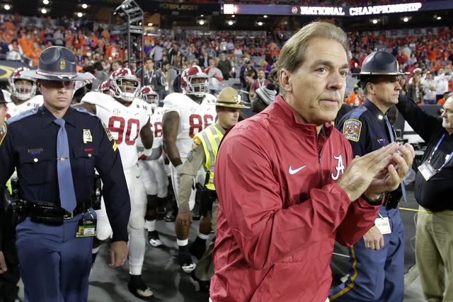 Alabama coach Nick Saban makes his way to the field before the NCAA college football playoff championship game against Clemson on Jan. 11, 2016, in Glendale, Ariz. (AP Photo/Chris Carlson)