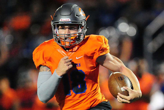 Bishop Gorman quarterback Tate Martell rushes for a first down against Cocoa, Fla,. in the first half of their prep football game at Bishop Gorman High School in Las Vegas Friday Sept. 2, 2016. (J ...