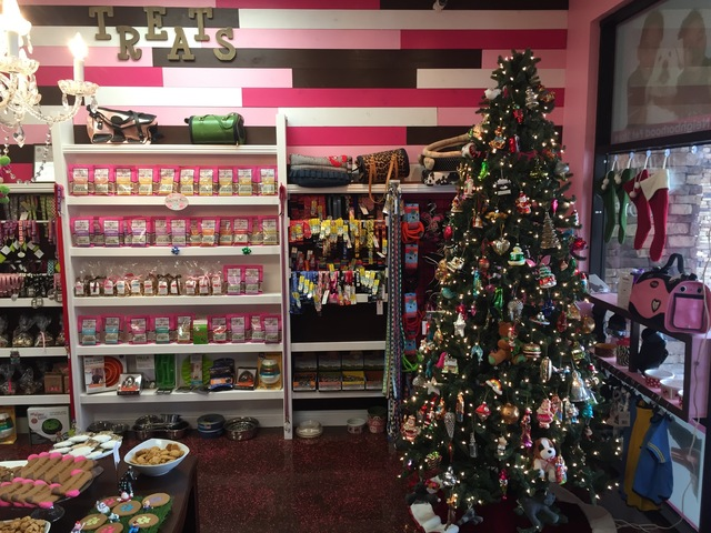 A Christmas tree in front of the treat wall inside Woof Gang Bakery & Grooming in Las Vegas on Wednesday, Dec. 21, 2016. (Raven Jackson/Las Vegas Review-Journal) @ravenmjackson