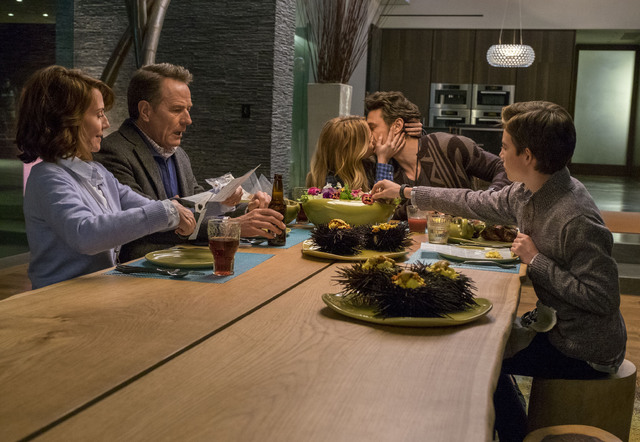 DF-01914_R2_CROP – Ned (Bryan Cranston) isn't happy when his future son-in-law Laird (James Franco) makes out with his daughter Stephanie (Zoey Deutch) at the dinner table, as Barb (Megan Mull ...