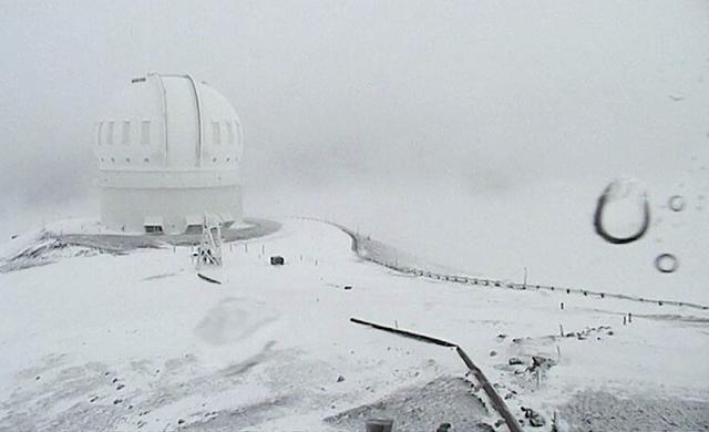 The CFHT telescope on the summit of Mauna Kea on Hawaii's Big Island is covered in snow on Thursday, Dec. 1, 2016. (Canada-France-Hawaii Telescope via AP)