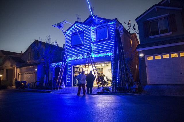Jeff and Karol Doody make last-minute adjustments to the holiday light show at their home on Tuesday, Nov. 29, 2016, in Las Vegas. Benjamin Hager/Las Vegas Review-Journal