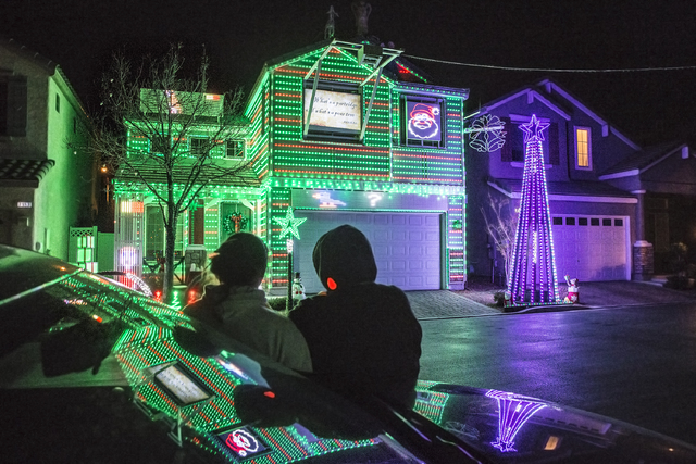 Jeff and Karol Doody watch the holiday light show at their home on Tuesday, Nov. 29, 2016, in Las Vegas. Benjamin Hager/Las Vegas Review-Journal