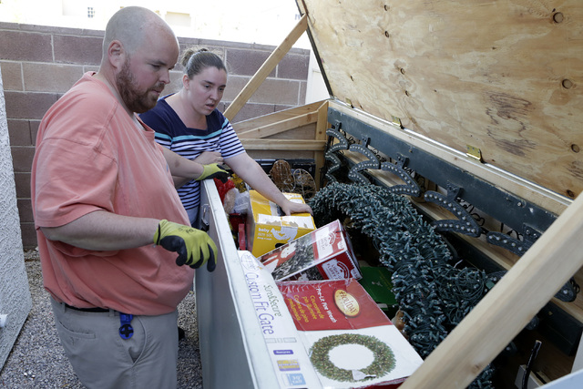 Jeff Doody and his wife Karol look inside their Christmas decoration storage box as they prepare to decorate their Las Vegas home, Tuesday, Nov. 22, 2016. Bizuayehu Tesfaye/Las Vegas Review-Journa ...