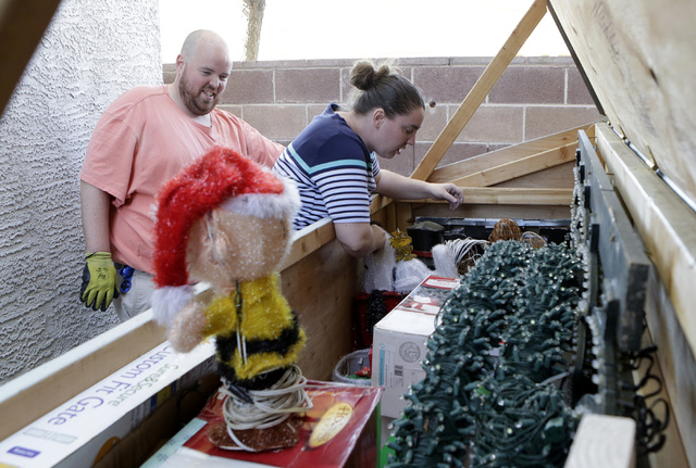 Jeff Doody and his wife Karol look inside their Christmas decoration storage as they prepare to decorate their Las Vegas home, Tuesday, Nov. 22, 2016. Bizuayehu Tesfaye/Las Vegas Review-Journal Fo ...