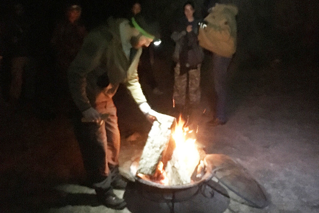 Ranger Randy Denter tends to a fire during the night walk on New Year's Eve (and early New Year's Day) at Spring Mountain Ranch State Park. BRIAN SANDFORD/VIEW