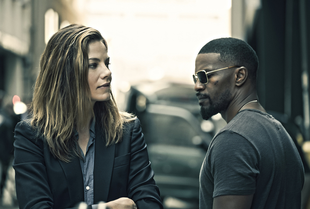 "Michelle Monaghan and Jamie Foxx star in ""Sleepless."" (Erica Parise / Open Road Films)"