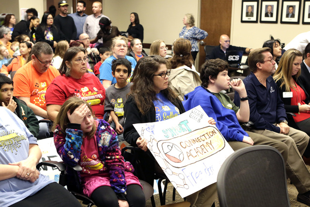 Parents and students supporting the online Nevada Connections Academy charter school, including Carly Held, center, and her son Nathan, 14, attend a public hearing on Friday, Dec. 16, 2016, at the ...