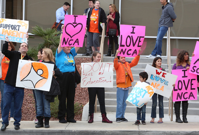 Parents and students supporting the online Nevada Connections Academy charter school protest outside the Nevada System of Higher Education building on Friday, Dec. 16, 2016, in Las Vegas. (Bizuaye ...