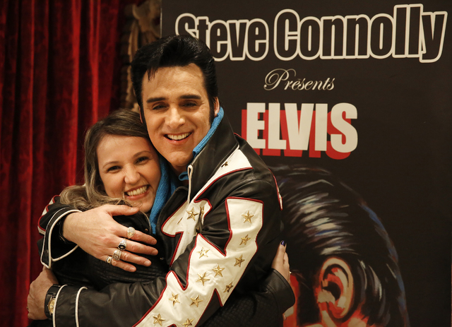 """Steve Connolly gets a hug from Tamiris Anibal (cq), of Brazil, following his performance as Elvis in """"Spirit of the King"""" at Four Queens hotel-casino on Saturday, Dec. 17, 2016 i ..."""