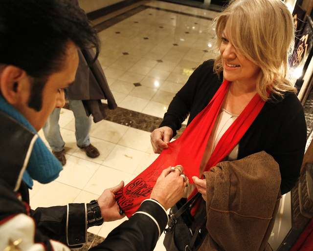 """Steve Connolly autographs a scarf for Kristi Akers, of Casper, Wyo., following his performance as Elvis in """"Spirit of the King"""" at Four Queens hotel-casino on Saturday, Dec. 17,  ..."""