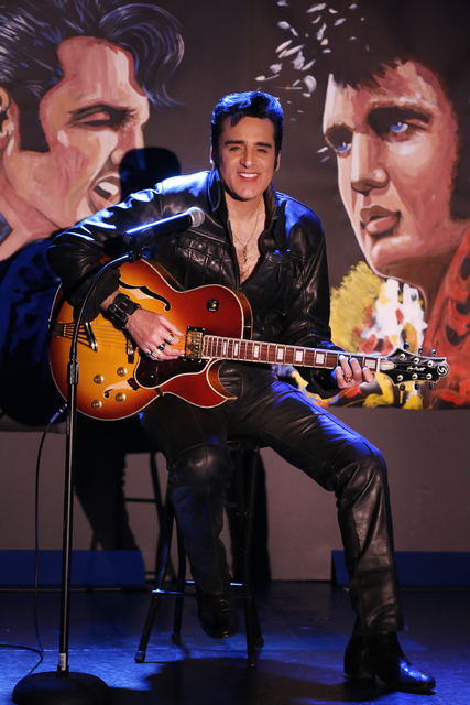 """Steve Connolly, who performs as Elvis in """"Spirit of the King"""", poses with two of his speed paintings (acrylic on archival paper) at Four Queens hotel-casino on Saturday, Dec. 17, ..."""