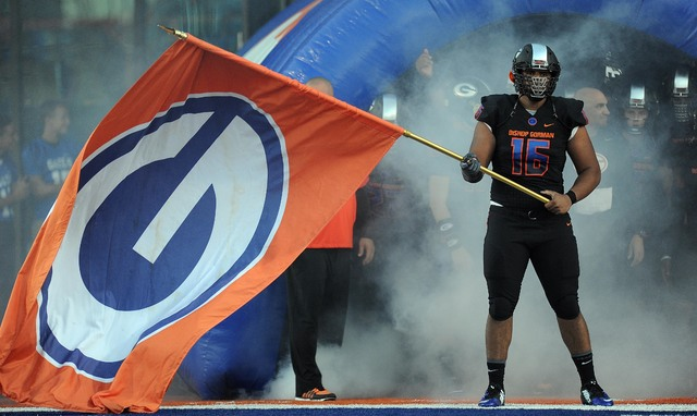 Bishop Gorman defensive lineman Haskell Garrett waves his team's flag before the start of their nationally televised high school football game against Chandler, AZ at Bishop Gorman High School in  ...