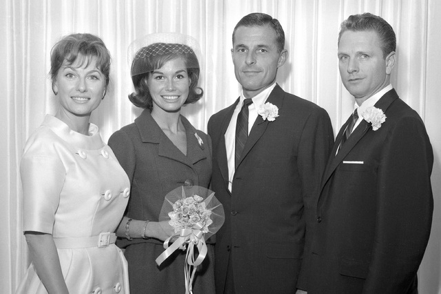 Mary Tyler Moore and Grant Tinker, middle, are seen with two unidentified people at Moore and Tinker's wedding June 1, 1962, at the Dunes in Las Vegas. (John Cook/Las Vegas News Bureau)