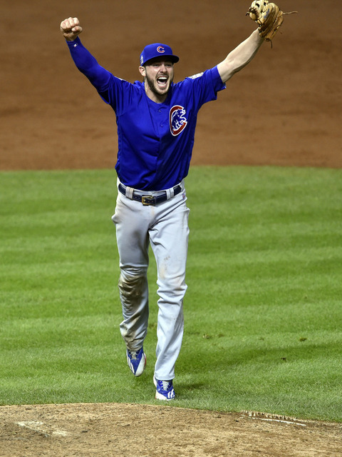 Nov 2, 2016; Cleveland, OH, USA; Chicago Cubs third baseman Kris Bryant celebrates after defeating the Cleveland Indians in game seven of the 2016 World Series at Progressive Field. (David Richard ...