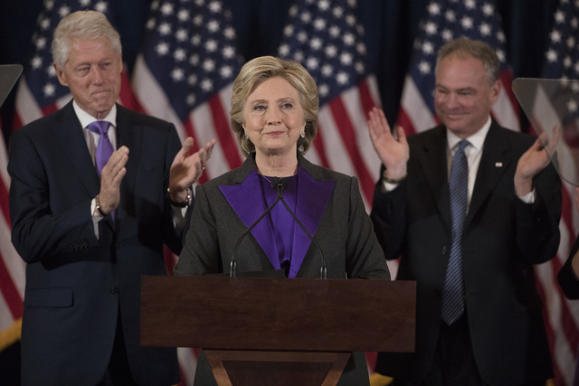 Former President Bill Clinton and Sen. Tim Kaine, D-Va. applaud as Democratic presidential candidate Hillary Clinton speaks in New York, Nov. 9, 2016, where she conceded her defeat to Republican D ...