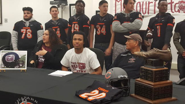 In this 2016 file photo, Chaparral senior Richard Nelson is flanked by his mother Roxanne Bruce and Chaparral football coach Paul Nihipali after signing his letter of intent to play at Missouri St ...