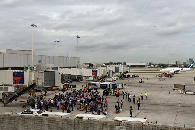Travelers are evacuated out of the terminal and onto the tarmac after airport shooting at Fort Lauderdale-Hollywood International Airport in Florida, U.S., January 6, 2017. (Zachary Fagenson/Reuters)