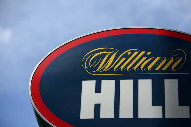 A branded sign is displayed outside a William Hill betting shop in London, Britain, July 25, 2016. (REUTERS/Neil Hall/File Photo)