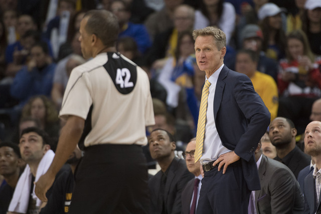 January 16, 2017; Oakland, CA, USA; Golden State Warriors head coach Steve Kerr (right) argues with NBA referee Eric Lewis (42) during the fourth quarter against the Cleveland Cavaliers at Oracle  ...