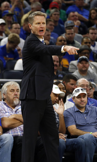 Jan 22, 2017; Orlando, FL, USA; Golden State Warriors head coach Steve Kerr reacts against the Orlando Magic during the first quarter at Amway Center. (Kim Klement/USA Today Sports)