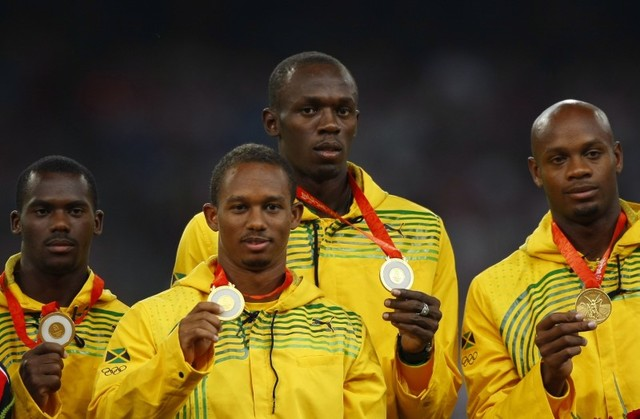 Gold medalists (L - R) Nesta Carter, Michael Frater, Usain Bolt, Asafa Powell of Jamaica pose during the medal ceremony for the men's 4 x 100m relay final of the athletics competition in the Natio ...