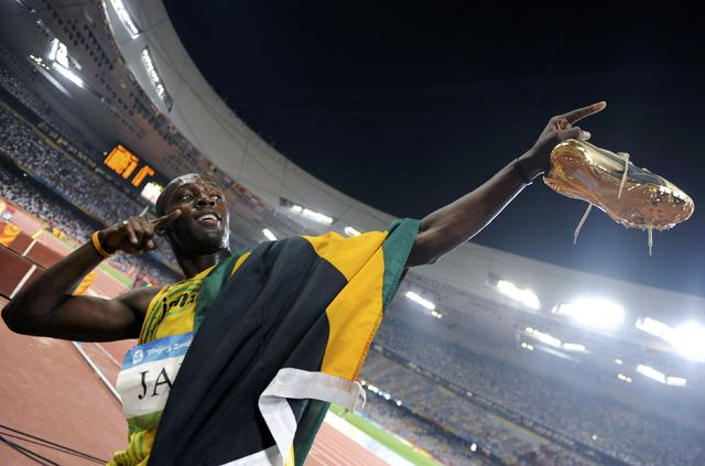 Usain Bolt of Jamaica celebrates after his team won the men's 4x100m relay athletics final in the National Stadium during the Beijing 2008 Olympic Games August 22, 2008.  Usain Bolt has lost one o ...