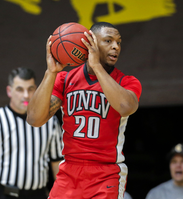 UNLV Runnin' Rebels forward Chrisian Jones (20) looks to pass against the Wyoming Cowboys during the first half at Arena-Auditorium. (Troy Babbitt/USA Today Sports)