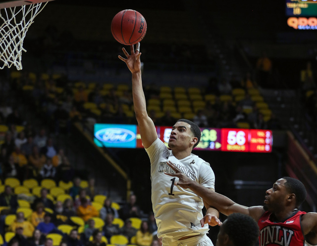 Wyoming Cowboys guard Justin James (1) shoots against the UNLV Runnin' Rebels during the second half at Arena-Auditorium. The Cowboys beat the Rebels 66-65. (Troy Babbitt/USA Today Sports)