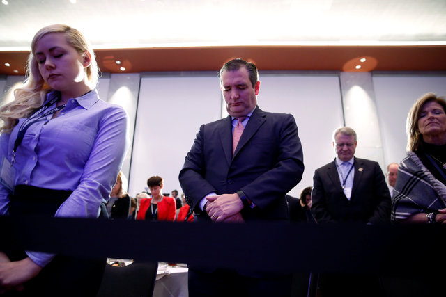 U.S. Sen. Ted Cruz, R-Texas, center, stands in prayer before President Donald Trump arrives to speak at a congressional Republican retreat in Philadelphia, Jan. 26, 2017. (Jonathan Ernst/Reuters)