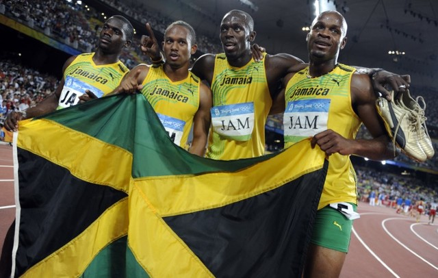 Men's 4x100m relay Asafa Powell, Usain Bolt, Michael Frater, Nesta Carter of Jamaica celebrate after winning the final of the athletics competition in the National Stadium during the Beijing 2008  ...