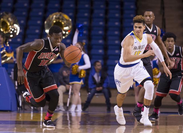 Jan 28, 2017; San Jose, CA, USA; UNLV Rebels guard Zion Morgan (10) dribbles the basketball San Jose State Spartans guard Isaiah Nichols (10) during the first half at San Jose State Event Center.  ...